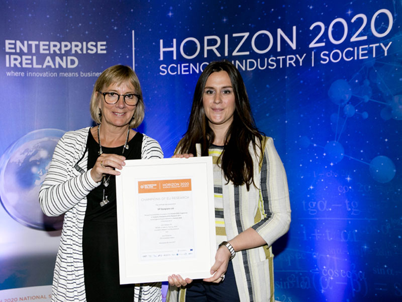 Roisin McCormack, Sales & Marketing Manager at DesignPro accepting the 'Champions of EU Research' award from Julie Sinnamon, CEO of Enterprise Ireland (June 2017).